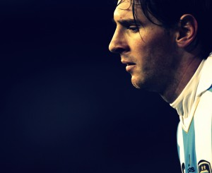 Messi of Argentina looks down as he walks during a friendly soccer match against Albania in Buenos Aires