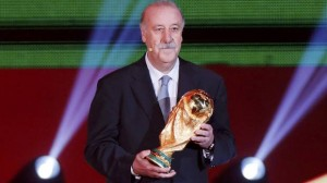 Spain's coach Vicente del Bosque holds the World Cup trophy on stage during the draw for the 2014 World Cup at the Costa do Sauipe resort in Sao Joao da Mata, Bahia state, December 6, 2013. (Reuters)