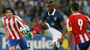 French soccer team midfielder Paul Pogba challenges for the ball (Associated Press)
