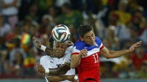Ghana's Andre Ayew fights for the ball with Alejandro Bedoya of the U.S. during their 2014 World Cup Group G soccer match at the Dunas arena in Natal June 16, 2014. (BRIAN SNYDER/REUTERS)