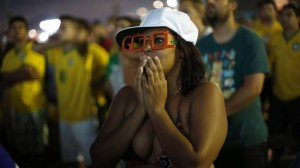 A soccer fan, cheering for Brazil, reacts during the team's 0-0 draw with Mexico on Tuesday. (Silvia Izquierdo/AP)